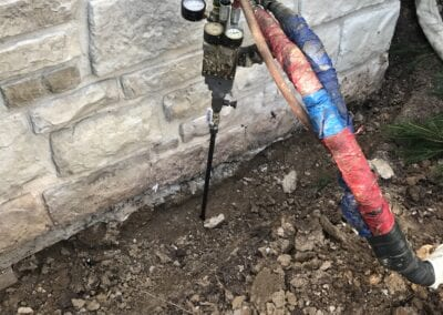 Deep foam injection to level a house foundation
